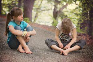 Two girls talking outside