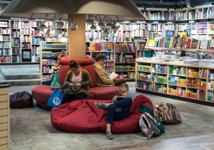 A young girl reads in the bean bag at the public library