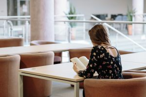 Female student sitting alone in the library.